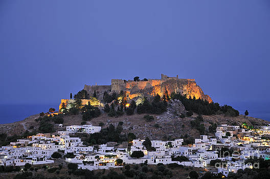 George Atsametakis - Acropolis and village of Lindos during dusk time