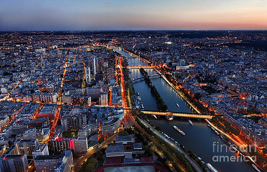 Aerial View of Paris at the Sunset by Radu Razvan