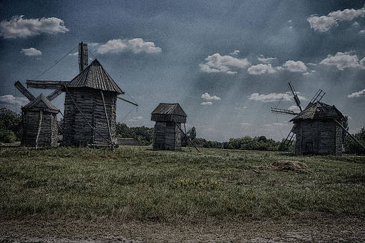 Aging Windmills by Munir El Kadi