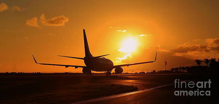 Aircraft during sunset by Mina Isaac