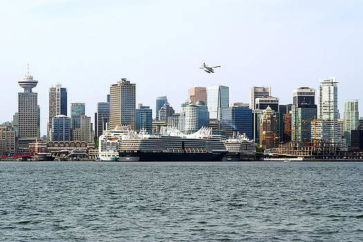 Airplane and Vancouver Skyline by Devinder Sangha