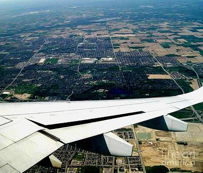 Gail Matthews - Airplane circling for landing in Toronto Airport