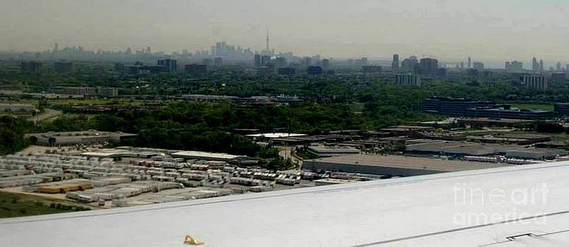 Gail Matthews - Airplane landing with CN Tower on horizon