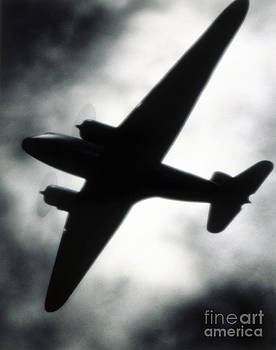 Airplane silhouette by Tony Cordoza