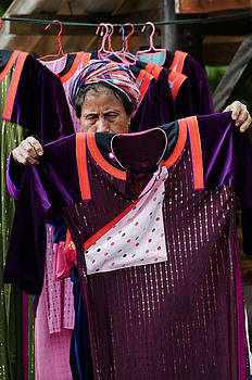Akha Woman and Fabric by Duane Bigsby