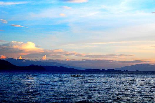 Alone at sea at dusk by Jun Camus