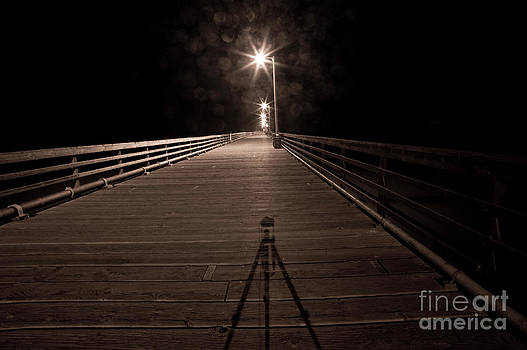 Alone on the Pier by Ronald Hoggard