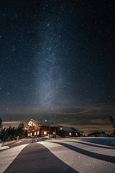 Alpine Cabin In Snowy Mountain Landscape At Night With The Milky by Leander Nardin