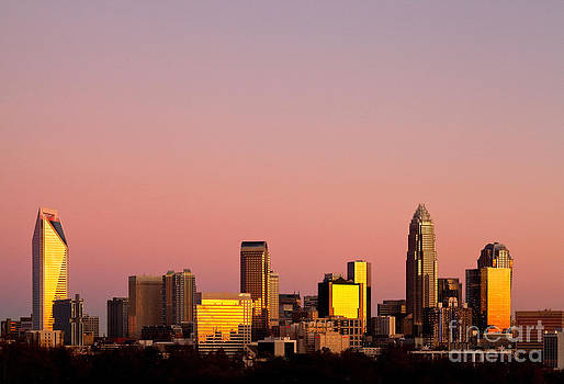 Amber skyline of Charlotte NC by Patrick Schneider