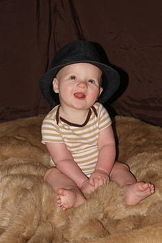 Andrew with a hat by Michelle Cawthon