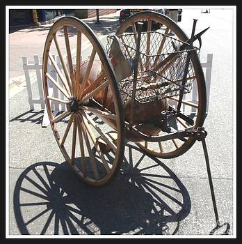 Gail Matthews - Antique Fire Extinguisher Wagon Wheels