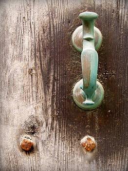 Pedro Cardona Llambias - antique minorcan latch in green on a vintage rustic door