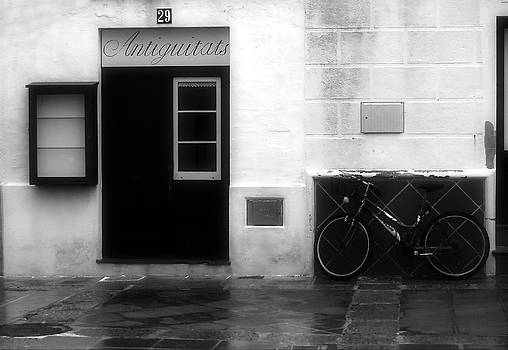 Pedro Cardona Llambias - Old village street with an antique shop and a bike remember us past times in Es Mercadal - Menorca