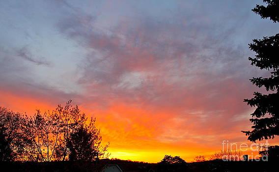 April Sunrise by Jay Nodianos