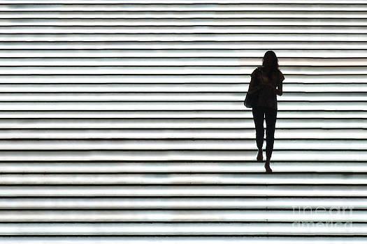 Art Silhouette of Girl walking down by Lars Ruecker
