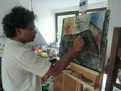 Artist at work in his studio   by Raju Mondhe