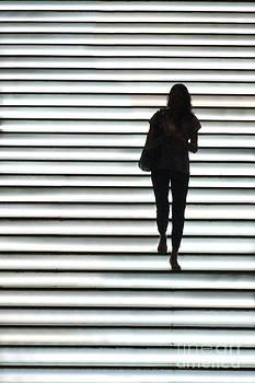 Artistic Silhouette Girl walking down by Lars Ruecker