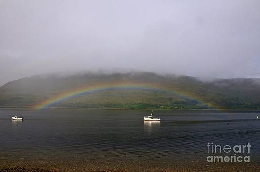 Autumn Rainbow over Loch Ness in Scotland by KamGeek Photography