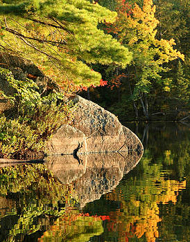 Autumn Reflection. Photograph - Trees and boulder reflected by Rob Huntley