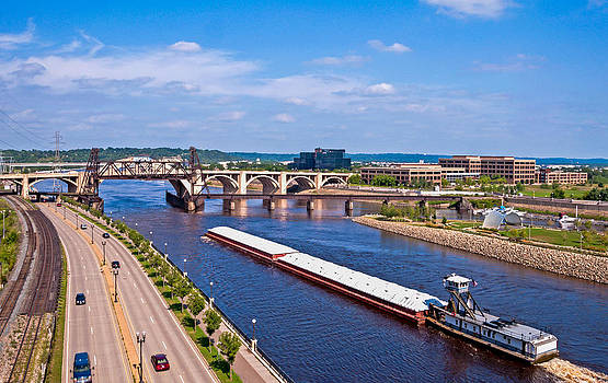 Barge on Mississippi River by Lonnie Paulson