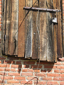 Barn door  by Marie-Pierre Sabga