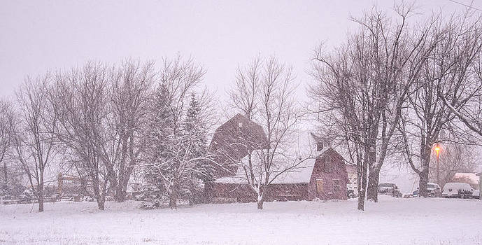 Barn in a Snowstorm by Guy Whiteley