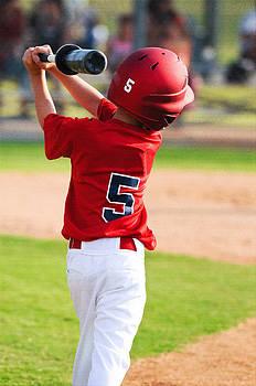 Baseball boy warming up to bat by Tammy Abrego