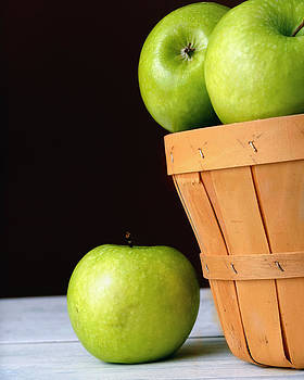 Basket of green apples by Dick Wood