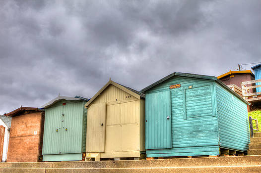 Fizzy Image - beach huts on a stormy day