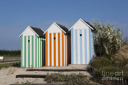 Beach Huts on a traffic roundabout in France near Roscoff. by Paul Felix