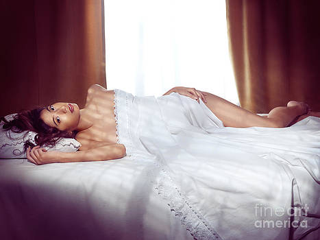 Beautiful young asian woman lting naked in bed covered with whit by Oleksiy Maksymenko