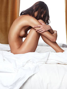 Beautiful young woman sitting naked on a bed by Oleksiy Maksymenko