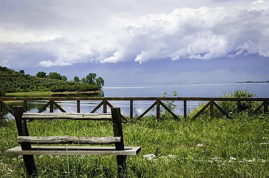 Bench by the lake. by Slavica Koceva