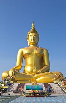Big Buddha image on blue sky background  by Kobchai Sukruean