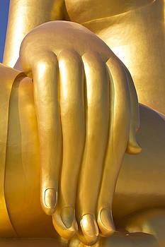 Big hand of big Buddha  image in Thailand temple  by Kobchai Sukruean