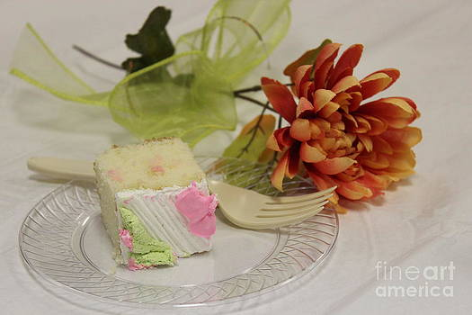 Birthday Cake on a plate with an orange Flower closeup by Robert D  Brozek