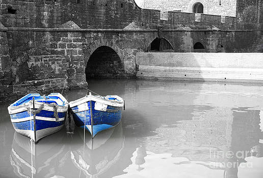 Deborah Benbrook - Black and white harbour with two blue boats