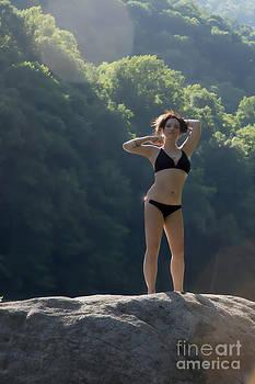 Dan Friend - black bikini on rock