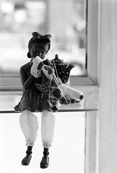 Harold E McCray - Black doll in window