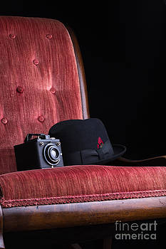 Edward Fielding - Black hat vintage camera and antique red chair