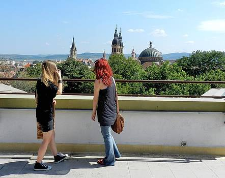 Ion vincent DAnu - Blonde and Red Hair Girls Admiring Sibiu Roofs