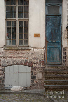 Blue Door in France by Amy Bynum