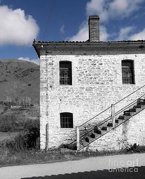 Ioanna Papanikolaou - blue sky white house