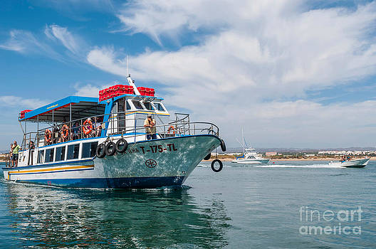 Boat to Tavira Island by Luis Alvarenga