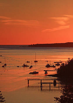 Boats and Moorings under an Orange Sunrise by Dana Moos