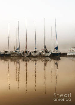 Boats moored in fog by Arletta Cwalina