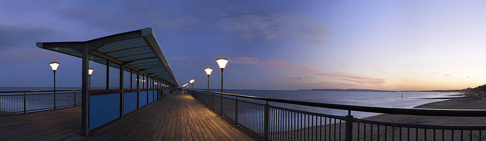Boscombe Pier at dusk by Adrian Brockwell