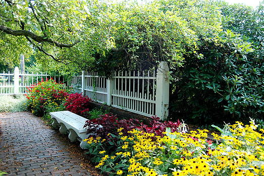 Pretty Park Bench Sits Within The Lovely Prescott Park Area Of Portsmouth New Hampshire by Eunice Miller