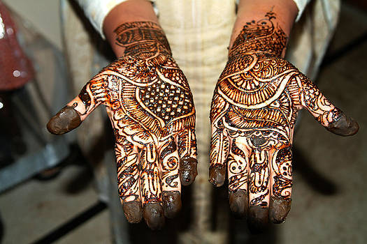 Devinder Sangha - Both Hands painted with Henna