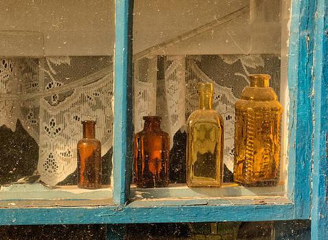 Bottles in a Fishing Shack by Nancy De Flon